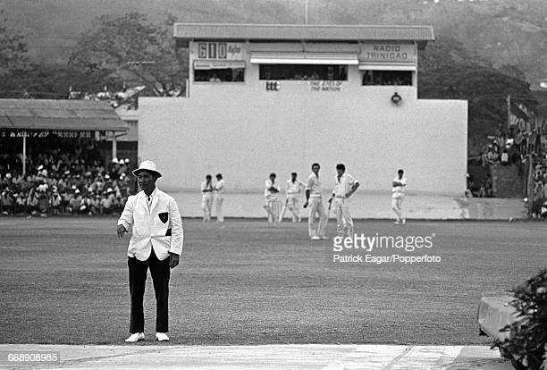 Umpire Douglas Sang Hue sorting out a sightscreen problem during the 3rd Test match between West Indies and Australia at the Queen's Park Oval,...