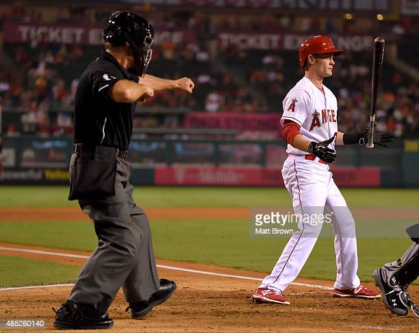 Umpire Ed Hickox signals a strikeout as Ryan Jackson of the Los Angeles Angels of Anaheim tosses his bat during the game against the Chicago White...