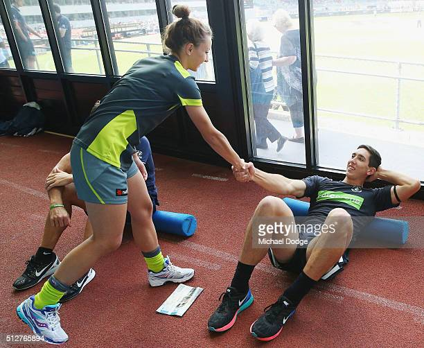 Umpire Eleni Glouftsis becoming the first female field umpire to adjudicate an official AFL match today shakes the hand of first gamer Jacob...