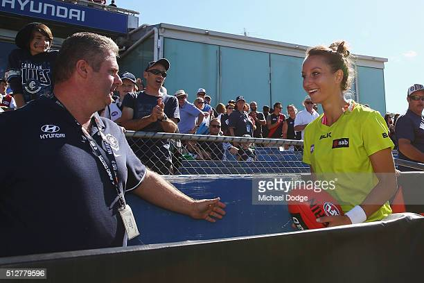 Umpire Eleni Glouftsis becoming the first female field umpire to adjudicate an official AFL match today is clapped off by fans after the 2016 AFL NAB...
