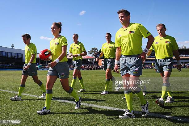 Umpire Eleni Glouftsis becoming the first female field umpire to adjudicate an official AFL match today leads the team off after the 2016 AFL NAB...
