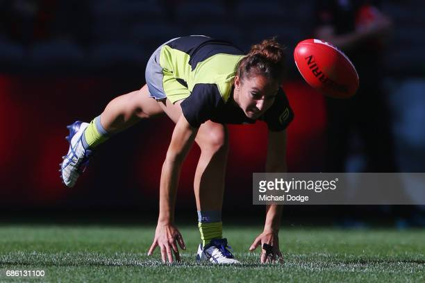 Umpire Ellen Glouftsis making her debut as the first ever women to umpire an AFL match bounces the ball in the warm up during the round nine AFL...