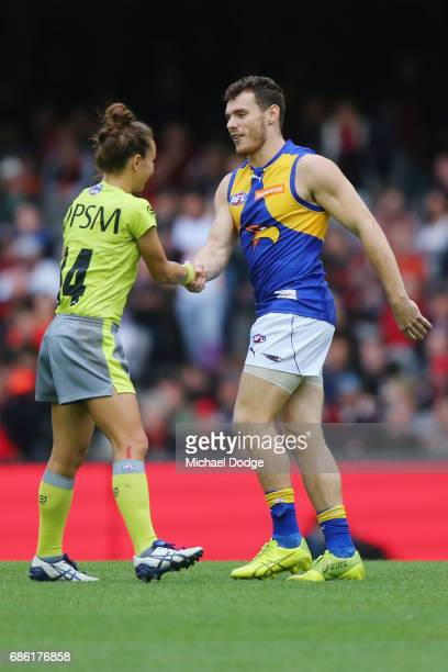 Umpire Ellen Glouftsis making her debut as the first ever women to umpire an AFL match is wished well by Luke Shuey of the Eagles during the round...