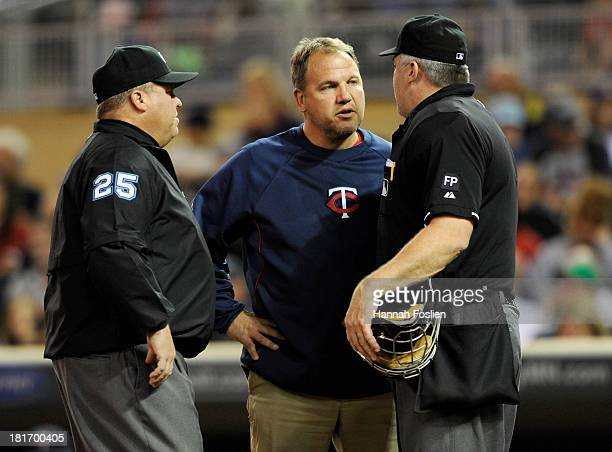Umpire Fieldin Culbreth and trainer Dave Pruemer for the Minnesota Twins check on home plate umpire Bill Welke after Welker was hit by foul tip...