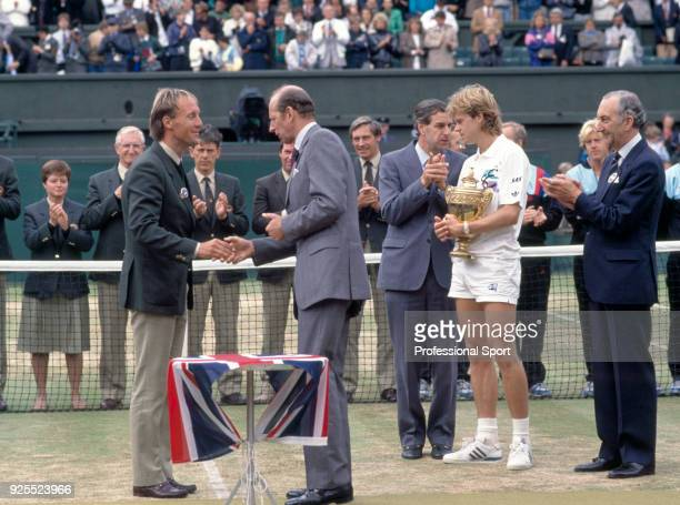 Umpire Gerry Armstrong shakes hands with the Duke of Kent after Stefan Edberg of Sweden defeats Boris Becker of West Germany in the Men's Singles...