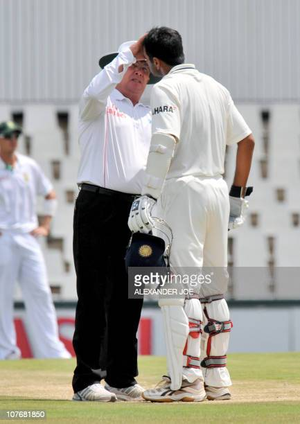 Umpire Ian Gould checksIndian batsman Rahul Dravid's eye during the forth day of the first Test match between India and South Africa at the...