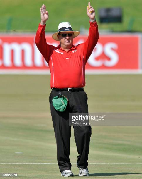 Umpire Ian Howell of South Africa indicates six run during the ICC Mens Cricket World Cup qualifier match between Kenya and Bermuda at Senwes Park on...