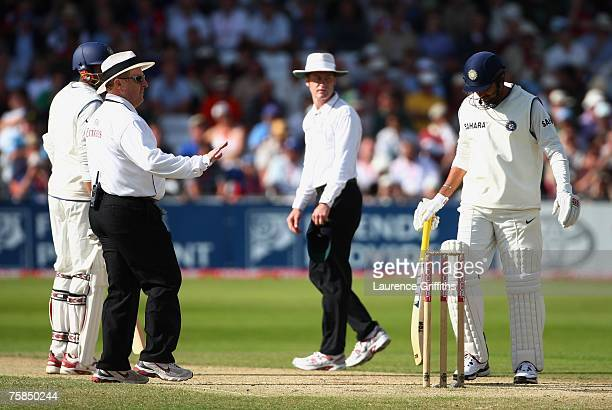 Umpire Ian Howell talks to Kevin Pietersen of England as umpire Simon Taufel and batsman Zaheer Khan of India look on during day three of the Second...