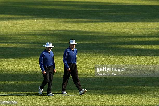Umpire Jamie Mitchell and Umpire James Hewitt walk from the field at stumps during the Futures League match between Western Australia and Victoria at...