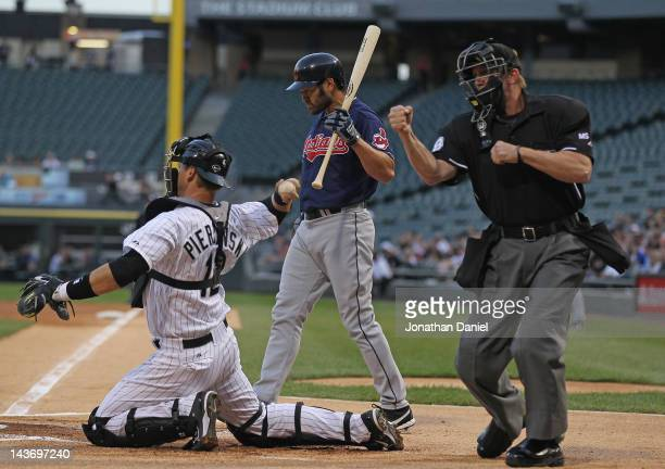 Umpire Jeff Kellogg calls out Johnny Damon of the Cleveland Indians on strikes in Damon's first at-bat for the Indians as A.J. Pierzynski throws the...