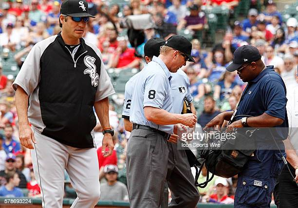 Umpire Jeff Kellogg looks at the review as Chicago White Sox manager Robin Venture walks away during a regular season MLB game between the Chicago...