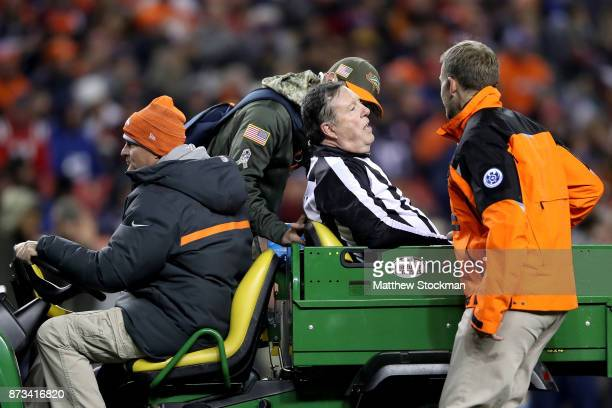 Umpire Jeff Rice is carted off the field after being injured officiating the Denver Broncos verses the New England Patriots at Sports Authority Field...