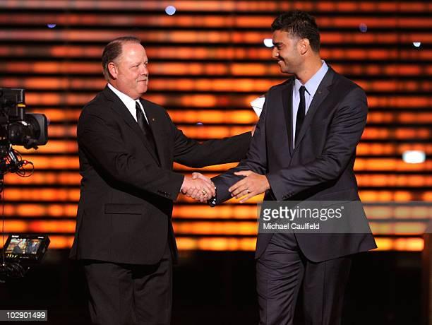 MLB umpire Jim Joyce and pitcher Armando Gallaraga shake hands onstage during the 2010 ESPY Awards at Nokia Theatre LA Live on July 14 2010 in Los...