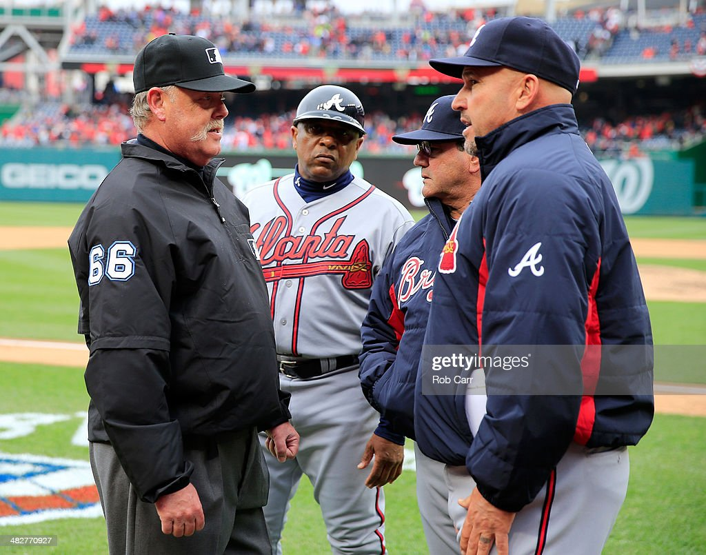 Umpire Jim Joyce #66 talks with manager Fredi Gonzalez #33 of the Atlanta Braves following the Braves 2-1 win over the Washington Nationals during the Nationals home opener at Nationals Park on April 4, 2014 in Washington, DC.
