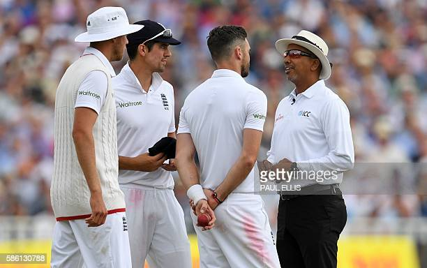 Umpire Joel Wilson explains to England's James Anderson England's captain Alastair Cook and England's Stuart Broad his decision to warn England's...