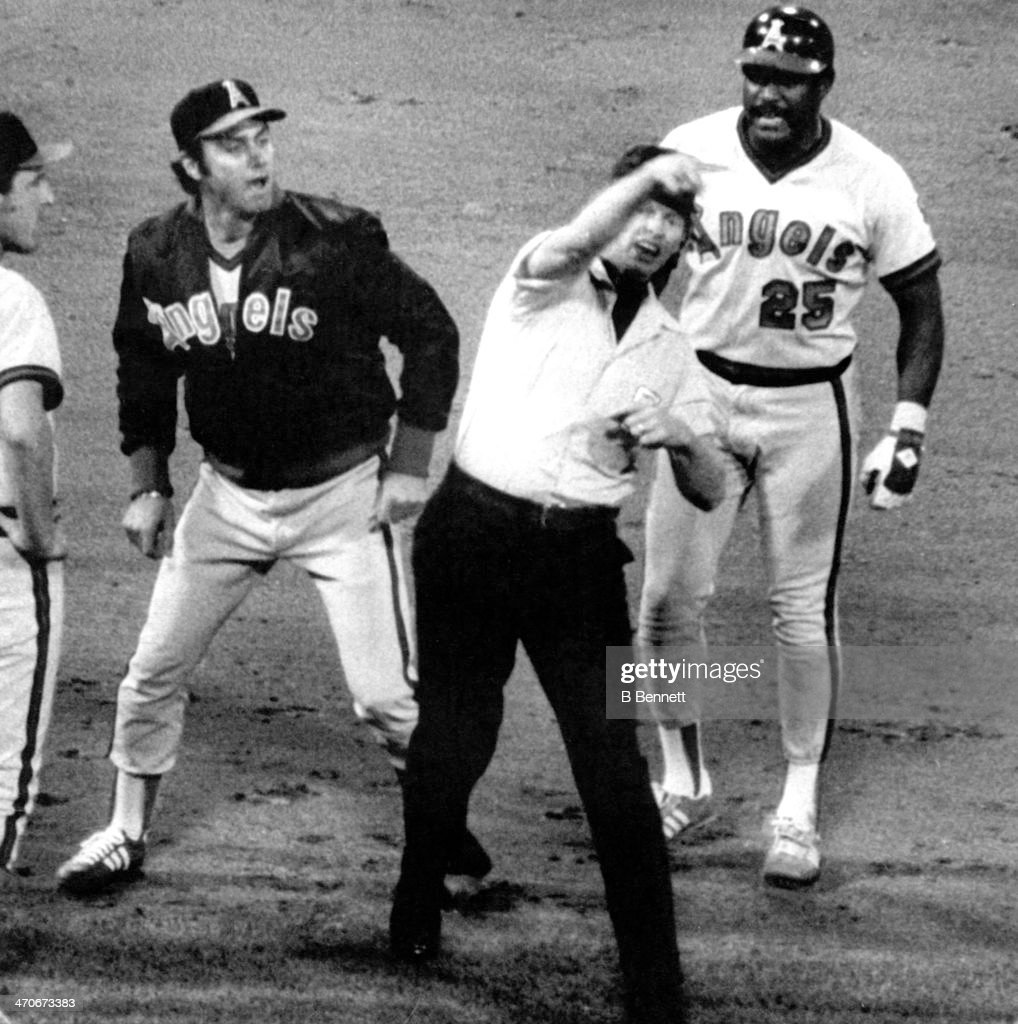 Umpire John Shulock throws out manager Jim Fregosi of the California Angels after Don Baylor #25 of the Angels was called out for running out of the base line during the game against the Boston Red Sox on May 9, 1979 at Fenway Park in Boston, Massachusetts.