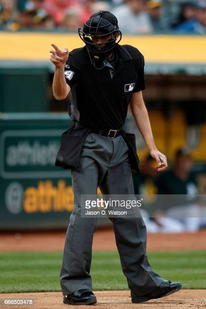 MLB umpire John Tumpane calls a strike during the second inning between the Oakland Athletics and the Los Angeles Angels of Anaheim at the Oakland...