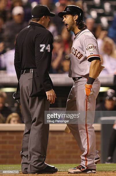 Umpire John Tumpane ejects Angel Pagan of the San Francisco Giants from the game for arguing balls and strikes after being called out on strikes...