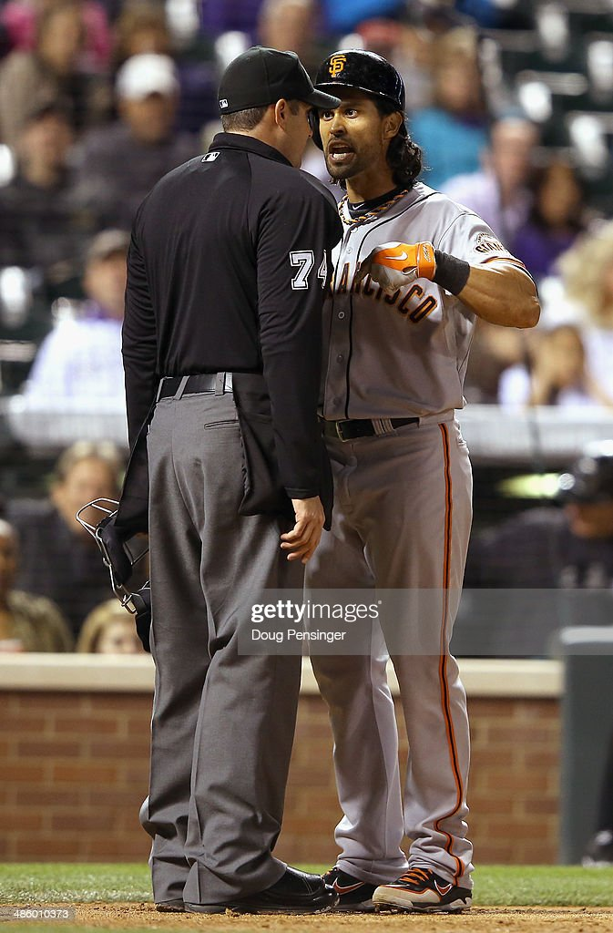 Umpire John Tumpane ejects Angel Pagan #16 of the San Francisco Giants from the game for arguing balls and strikes after being called out on strikes against Tommy Kahnle #54 of the Colorado Rockies in the seventh inning at Coors Field on April 21, 2014 in Denver, Colorado. The Rockies defeated the Giants 8-2.