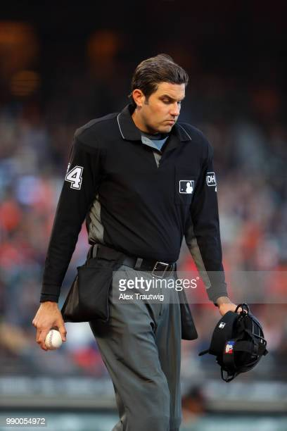 Umpire John Tumpane looks on during a game between the Colorado Rockies and the San Francisco Giants at ATT Park on Tuesday June 26 2018 in San...