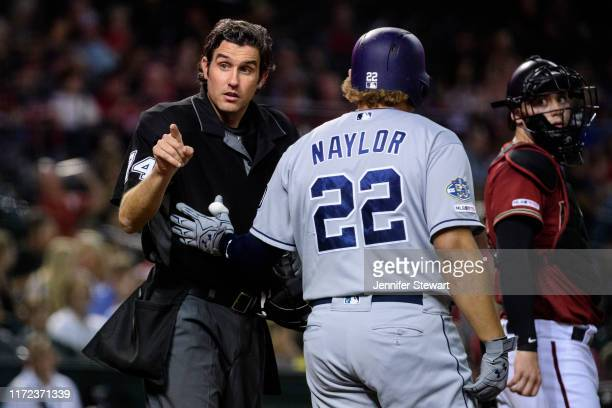 Umpire John Tumpane points at Manny Machado of the San Diego Padres for arguing balls and strikes as Josh Naylor walks up to bat in the fourth inning...