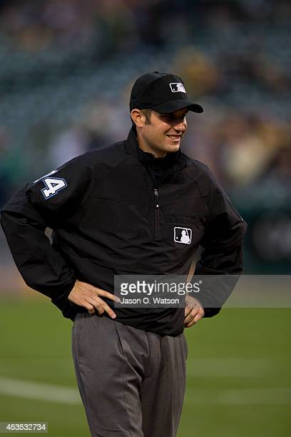 MLB umpire John Tumpane stands on the field before the game between the Oakland Athletics and the Tampa Bay Rays at Oco Coliseum on August 5 2014 in...