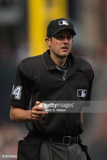 MLB umpire John Tumpane stands on the field during the eighth inning between the San Francisco Giants and the Los Angeles Dodgers at ATT Park on...