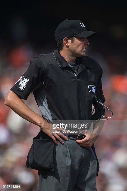 MLB umpire John Tumpane stands on the field during the sixth inning between the San Francisco Giants and the Los Angeles Dodgers at ATT Park on April...
