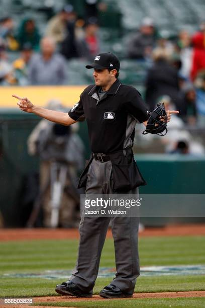 MLB umpire John Tumpane stands on the field during the sixth inning between the Oakland Athletics and the Los Angeles Angels of Anaheim at the...