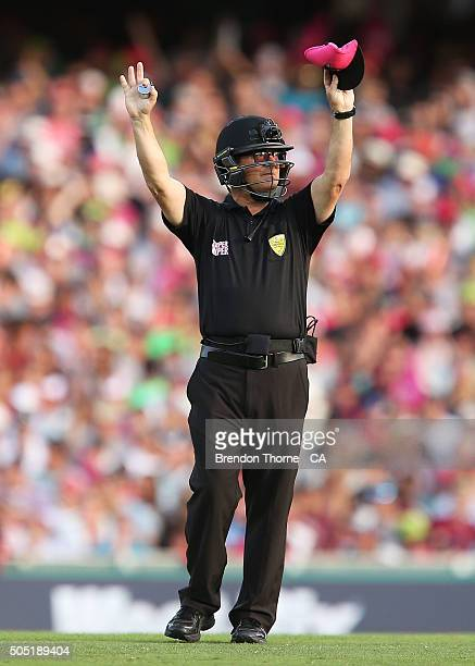 Umpire John Ward signals a 'six' during the Big Bash League match between the Sydney Sixers and the Sydney Thunder at Sydney Cricket Ground on...