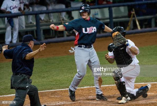 Umpire Juan Rodriguez makes a safe call after Lou Marson of