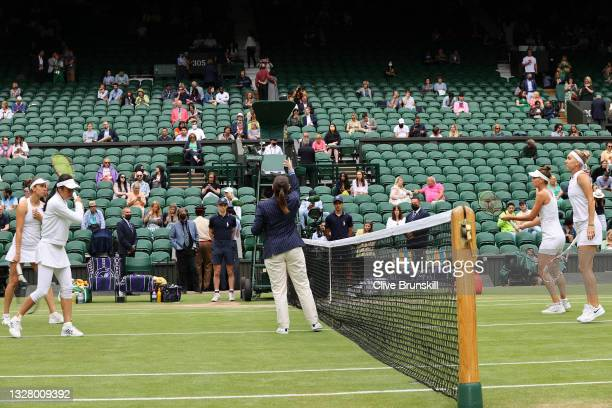 Umpire Kelly Thomson at the coin toss for the Ladies' Doubles Final match between Veronika Kudermetova of Russia and playing partner Elena Vesnina of...