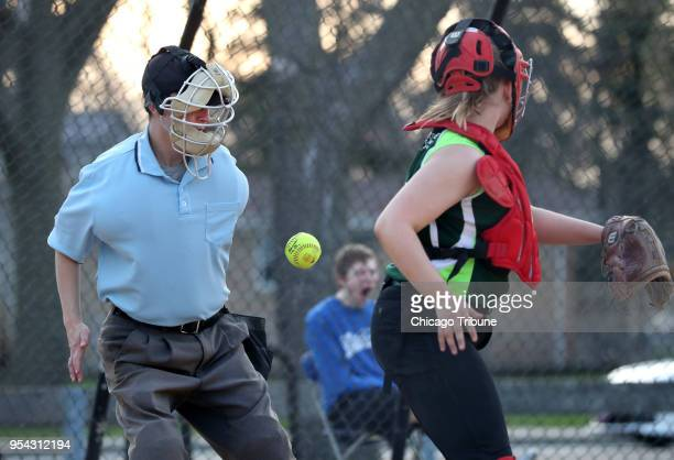 Umpire Kody O'Connor is hit by the ball during a 14U softball game on Tuesday May 1 2018 at Pioneer Park in Niles Ill