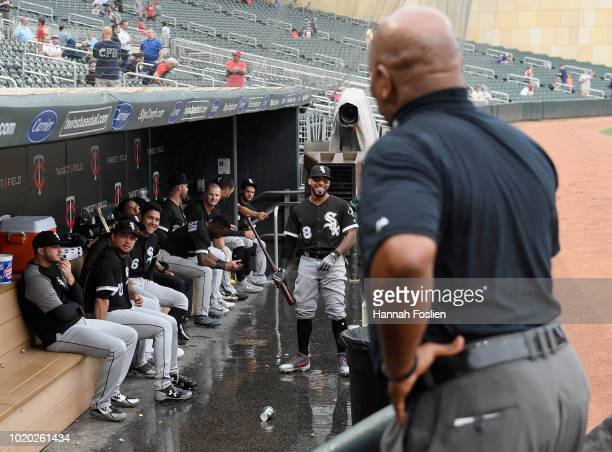 Umpire Laz Diaz speaks with the Chicago White Sox dugout as rain delays the game against the Minnesota Twins on August 20 2018 at Target Field in...