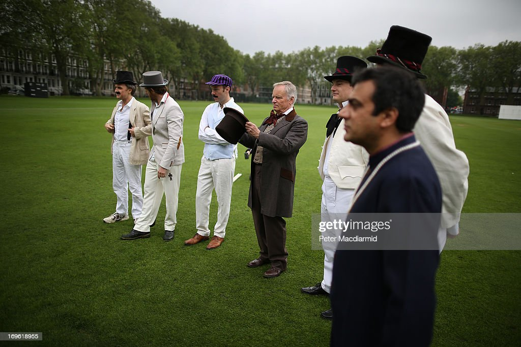 Umpire Lord Archer inspects his top hat as he stands with the Wisden XI and Authors XI teams before a Victorian cricket match at Vincent Square on May 29, 2013 in London, England. The match celebrates the 150th anniversary the Wisden Cricketers' Almanack. The almanack is a cricket reference book published annually in the United Kingdom.