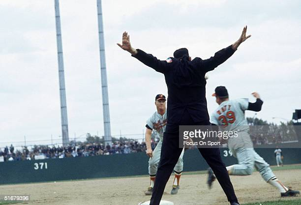 Umpire makes a safe call on Eddie Watt a Baltimore Oriole during the World Series against the New York Mets at Shea Stadium on October 1969 in...