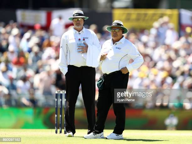 Umpire Marais Erasmus and Reserve Umpire Paul Wilson look on after Mark Stoneman of England was dismissed by Mitchell Starc of Australia during day...