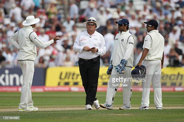Umpire Marais Erasmus talks to the Indian players after Ian Bell of England is controversially run out during the second npower Test match between...