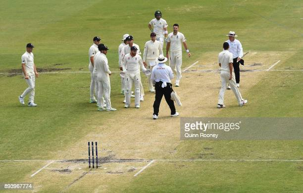 Umpire Marais Erasmus talks with the English players following the dismissal of Mitchell Starc of Australia during day four of the Third Test match...