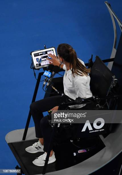 Umpire Marijana Veljovic looks at her tablet as Japan's Naomi Osaka plays Czech Republic's Karolina Pliskova during their women's singles semifinal...