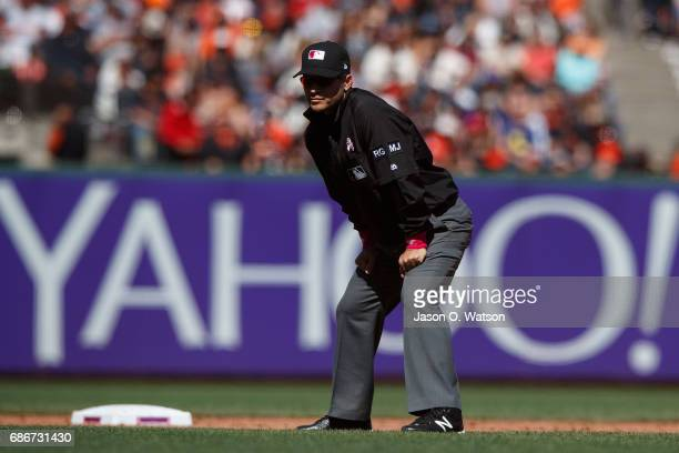 MLB umpire Mark Wegner stands on the field during the ninth inning between the San Francisco Giants and the Cincinnati Reds at ATT Park on May 14...