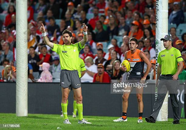 Umpire Matt Stevic signals for the first ever video review of a goal decision in a Premiership match during the round one AFL match between the...
