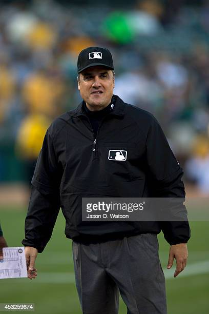 MLB umpire Mike DiMuro stands on the field before the game between the Oakland Athletics and the Kansas City Royals at Oco Coliseum on August 1 2014...