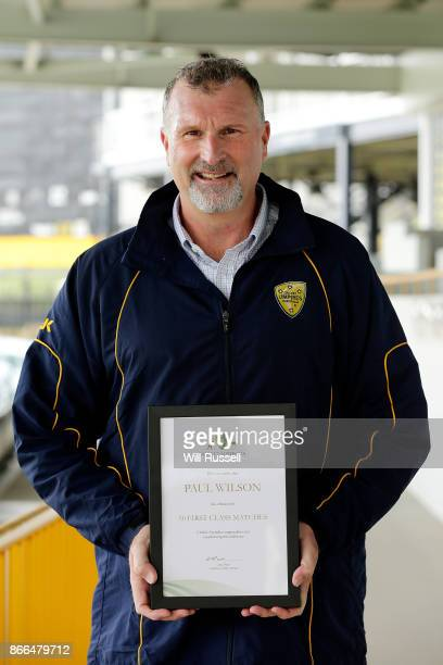 Umpire Paul Wilson poses with his certificate for 50 First Class fixtures during day one of the Sheffield Shield match between Western Australia and...
