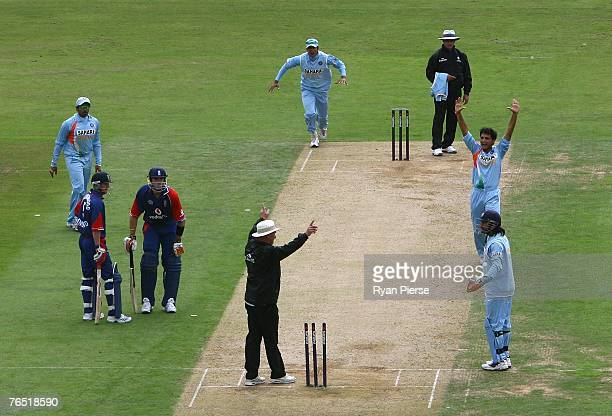 Umpire Peter Hartley calls for the video replay for a runout appeal for Paul Collingwood of England during the 6th NatWest One Day International...