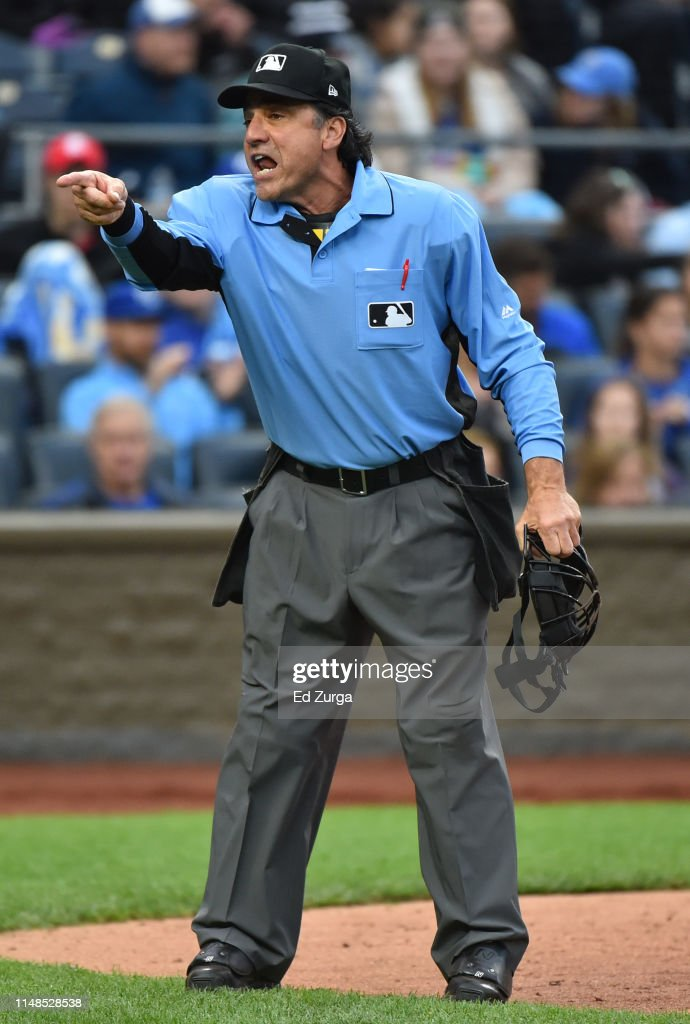 Umpire Phil Cuzzi gestures to ...
