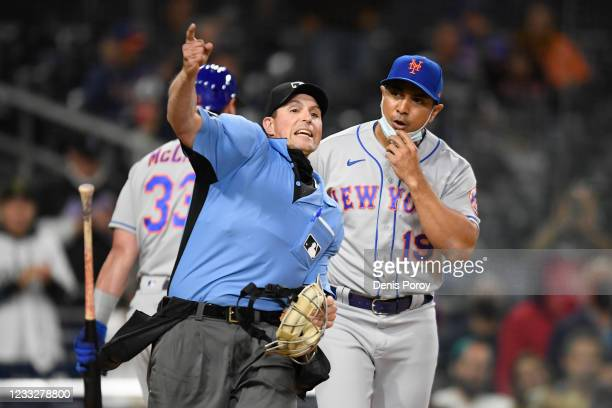 Umpire Quinn Wolcot ejects New York Mets manager Luis Rojas from the game during the ninth inning of a baseball game against the San Diego Padres at...