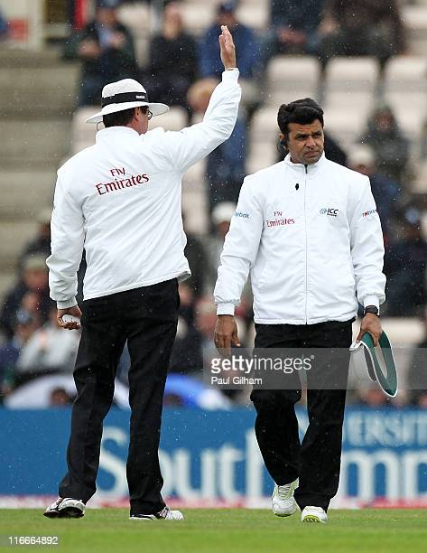 Umpire Rod Tucker and Aleem Dar takes the players off as rain falls during day two of the 3rd npower Test Match between England and Sri Lanka at the...