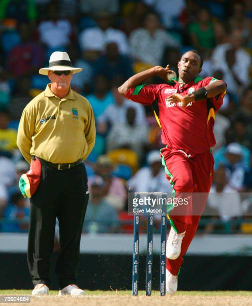 Umpire Rudi Koertzen looks on as Dwayne Bravo of West Indies bowls during the ICC Cricket World Cup Super Eights match between West Indies and...