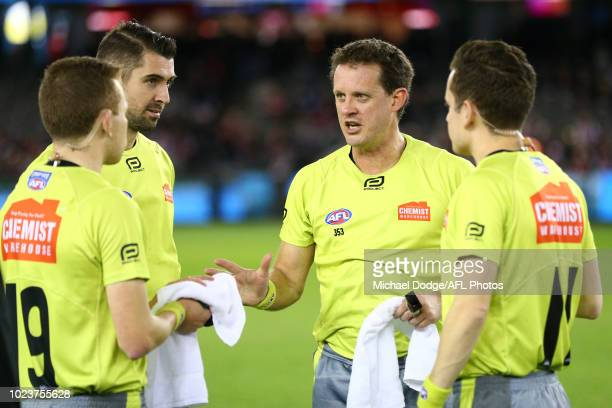 Umpire Shane McInerny gives advice during the round 23 AFL match between the St Kilda Saints and the North Melbourne Kangaroos at Etihad Stadium on...